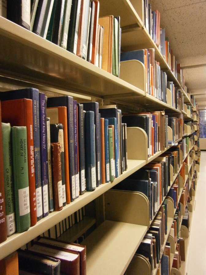 Suzzallo Library, shelves full of Shakespeare criticism