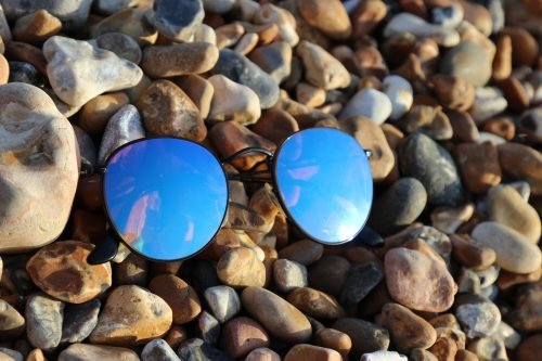 black-farmed-sunglasses-on-rocks-1035733