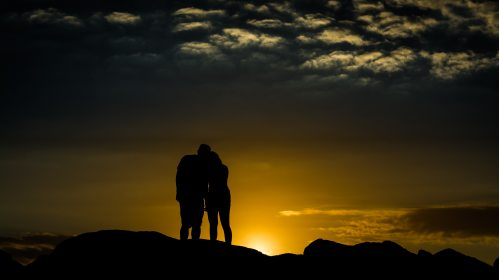 silhouette-photo-of-man-and-woman-1121472
