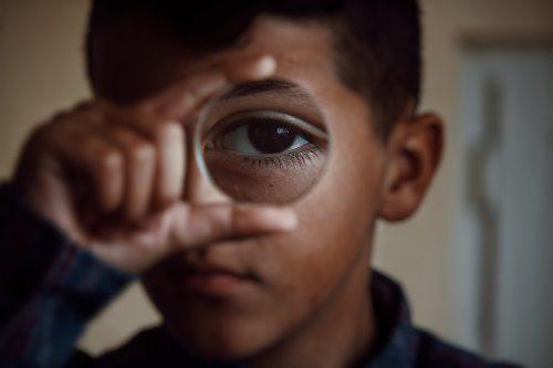 little-boy-holding-magnifying-lens-3372087