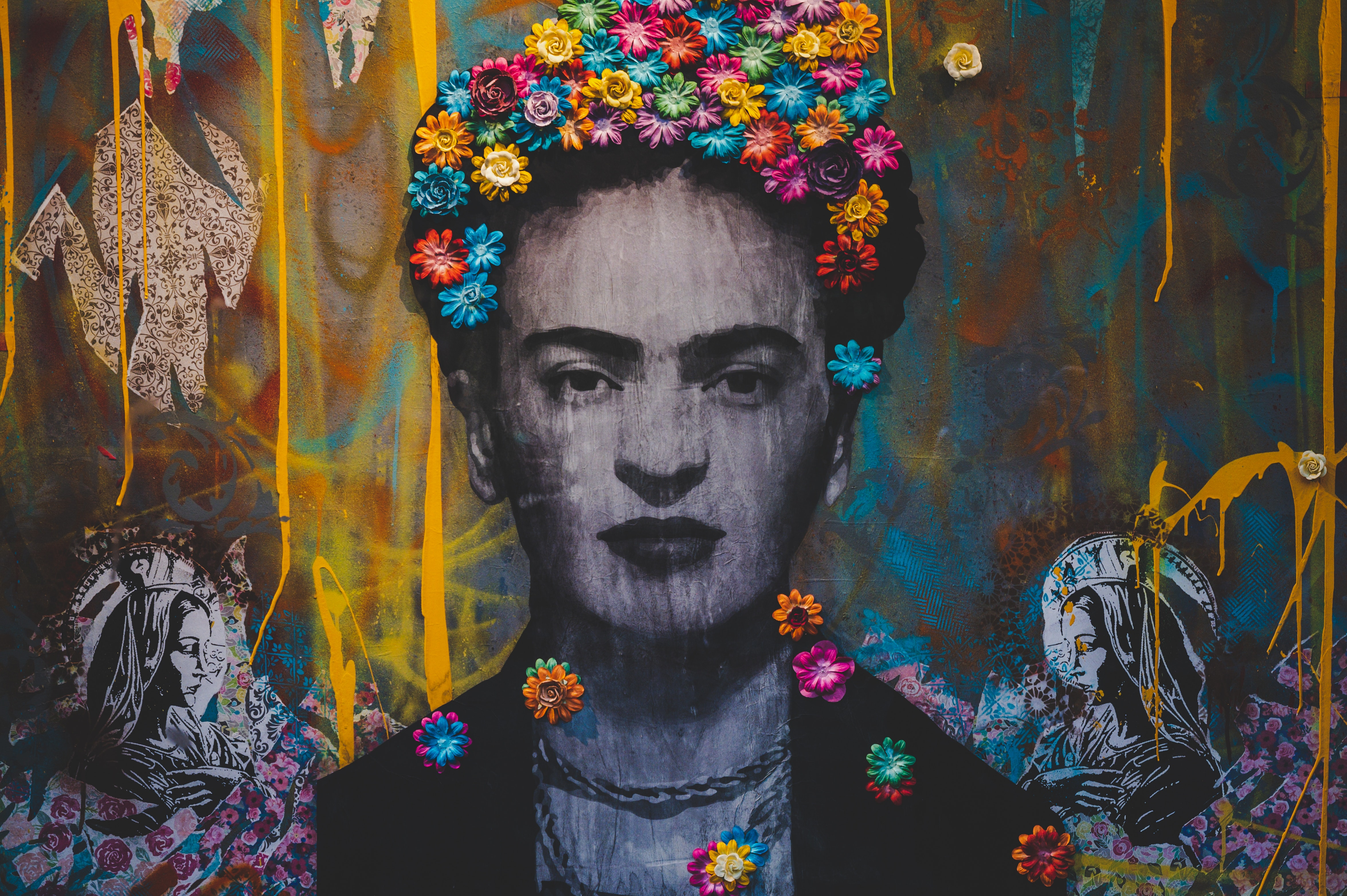 Graffiti portrait of Frida Kahlo with a crown of colorful flowers